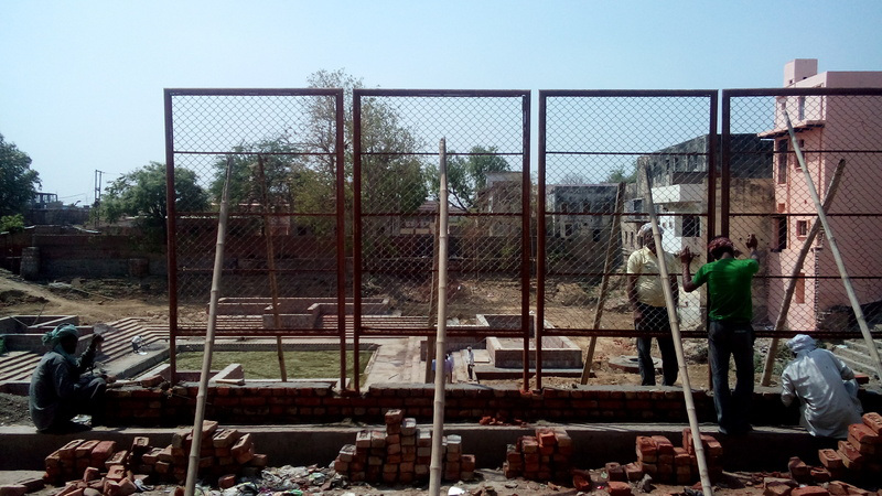 Protective chainlink fencing at the Parikrama Marg side of the boundary