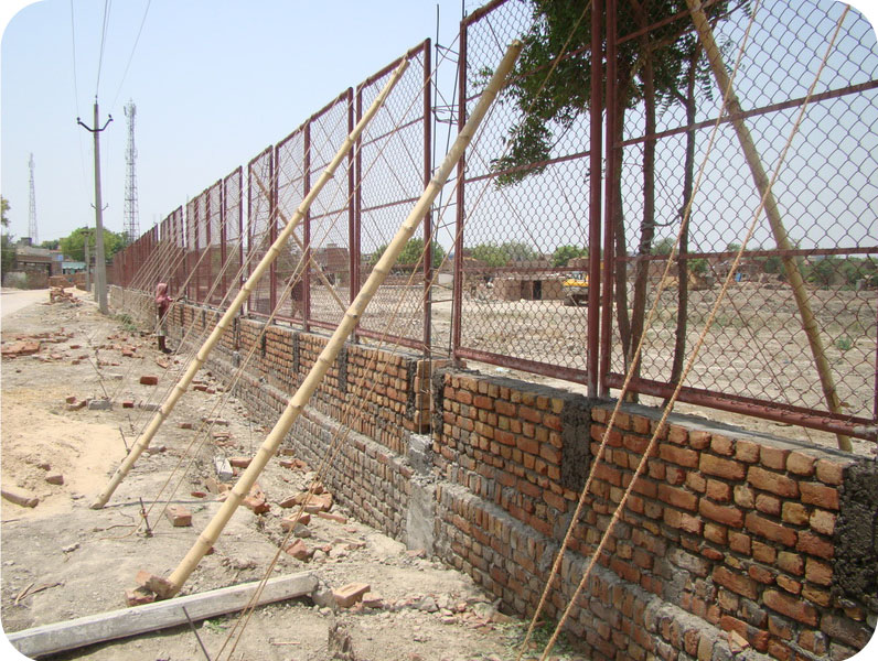 Protective chainlink fencing at the boundary wall