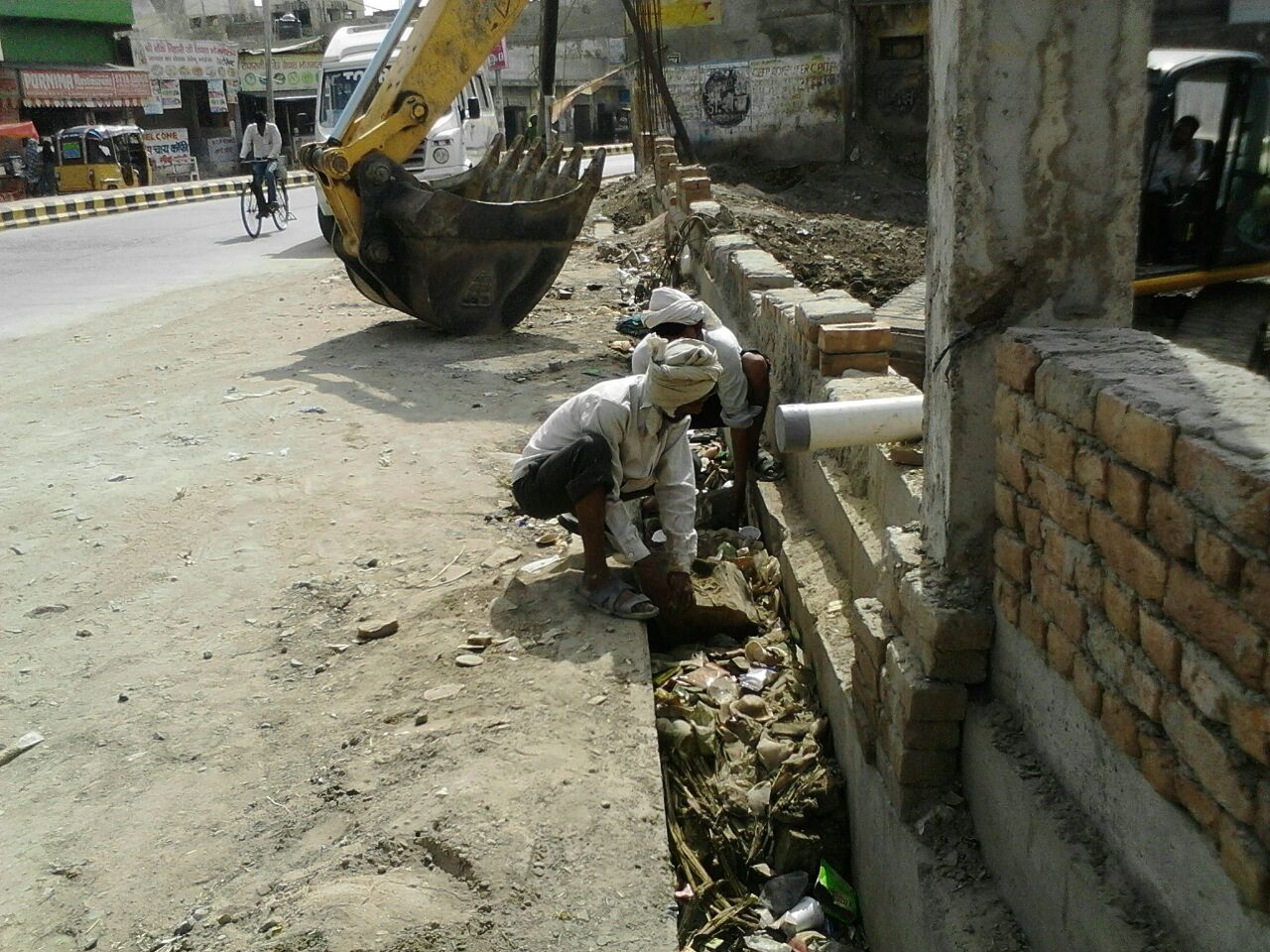 Cleaning of drain near Rinmochan Kund